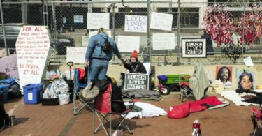 Protesters Chain Themselves To Minneapolis Courthouse